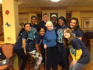 TU students gather around for a picture after a day of service in Towson.
